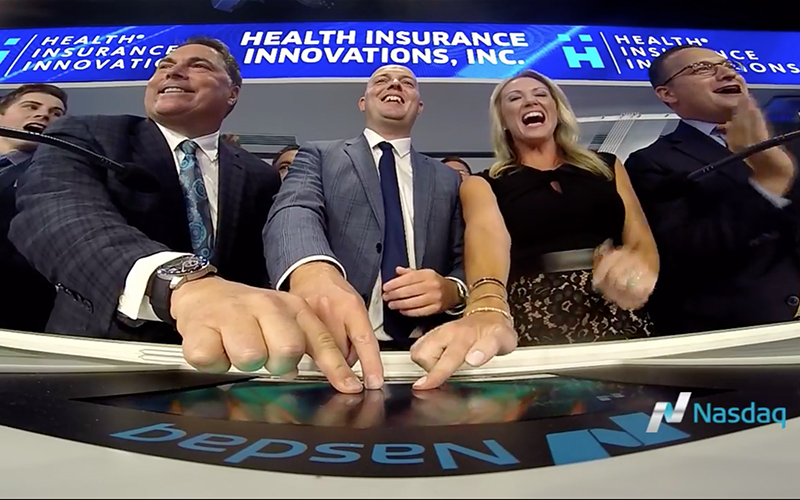 Health Insurance Innovation's founders Mike and Lori Kosloski join CEO Gavin Southwell in ringing the closing bell at the NASDAQ MarketSite in Times Square
